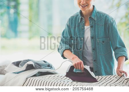 Housework Concept, Close-up Woman Ironing