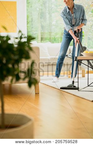 Woman Vacuum Carpet In House