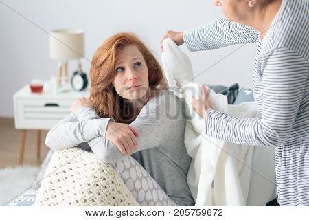 Mother Supporting Daughter With Flu