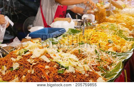Pad Thai is famous Thai food. Thai noodle on street food market in Bangkok Thailand. It is delicious and happy to eat.