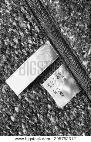 Small size clothes label on gray wool background