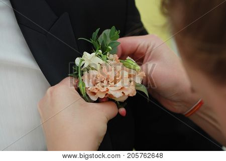 Wedding posy on the lapel of groom's jacket