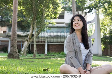Asian Woman Portrait. Young Female Adult With Natural Make-up Relax In Park. Attractive Teenager Smi