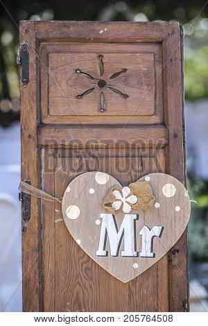 Old wooden shutter windows with hanging heart for Mr. Vintage decoration for weddings