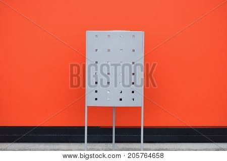 trash can on the background of an orange wall