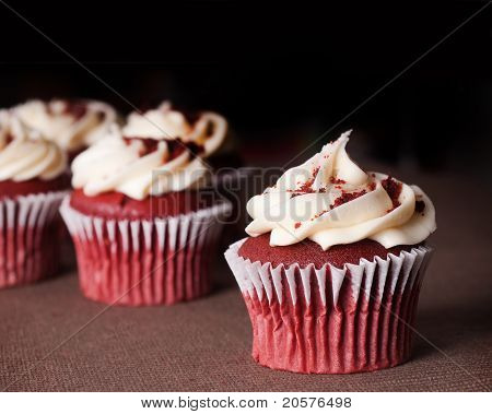 red velvet cupcakes on brown table