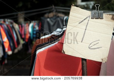 One euro price tag attached to the clothes hanging on the hangers
