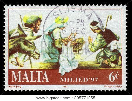 Malta - CIRCA 1997: A stamp printed in Malta shows Mary and baby Jesus, adoration of the Magi, Christmas (1997), circa 1997