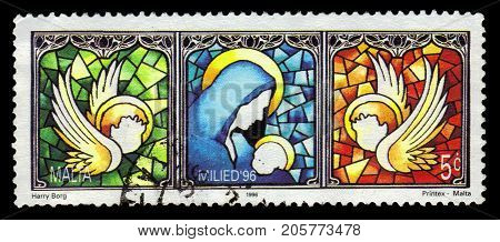 Malta - CIRCA 1996: A stamp printed in Malta shows Mary and baby Jesus, stained glass window, Christmas (1996), circa 1996