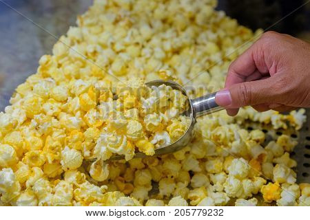 Sweet popcorn shop close up view on background