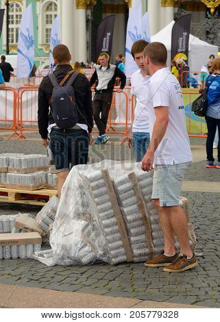 09.07.2017.Russia.Saint-Petersburg.Workers carry pallets of beer.During transport the pallets fell.