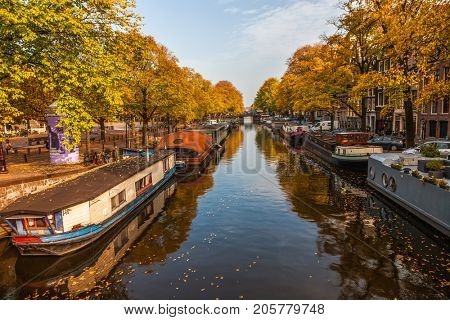 AMSTERDAM, THE NETHERLANDS - OCT 26, 2016: beautiful canals in Amsterdam in autumn, Holland