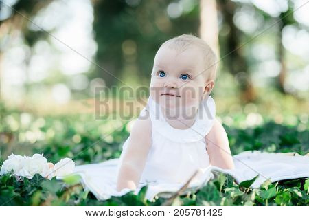 Baby Girl 8 Months Old Portrait Outdoors In Sunlight