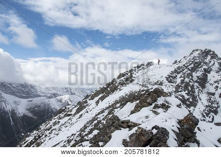 Picture of a man  standing on top of Little Arethusa in Kananaskis Country, Alberta,Canada.