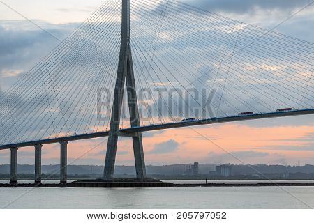 Sunrise view at Pont de Normandie bridge over river Seine between Le Havre and Honfleur in France