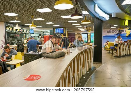 SAINT PETERSBURG, RUSSIA - CIRCA AUGUST, 2017: McDonald's at Pulkovo airport in Saint Peterburg. McDonald's is an American hamburger and fast food restaurant chain.