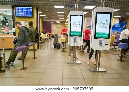 SAINT PETERSBURG, RUSSIA - CIRCA AUGUST, 2017: McDonald's at Pulkovo airport in Saint Peterburg. McDonald's is an American hamburger and fast food restaurant chain.