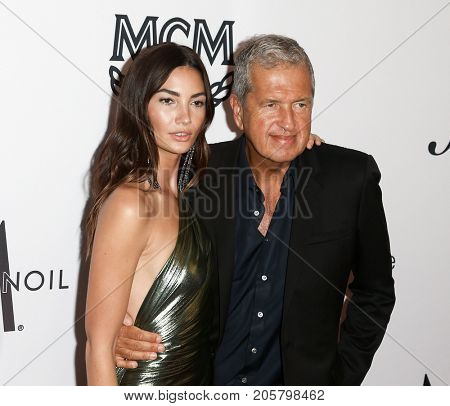 NEW YORK-SEPT 08: Model Lily Aldridge (L) and photographer Mario Testino attends Daily Front Row's Fashion Media Awards at Four Seasons Hotel New York Downtown on September 8, 2017 in New York City.