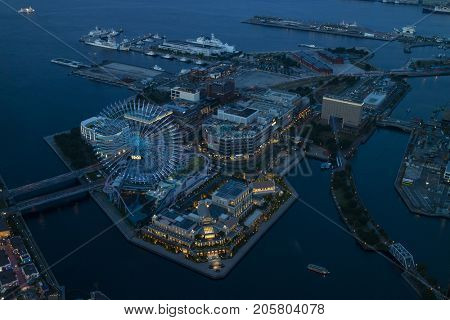 Yokohama, Japan - June 15, 2017: View from the Landmark Tower at night to the Yokohama Cosmo World Amusement Park and harbour