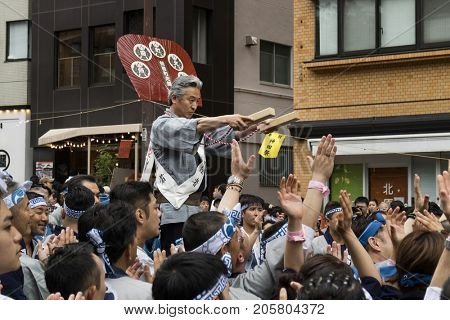 Tokyo, Japan - May 14, 2017: Leader of the community gives the sign for lifting a Matsuri Shinto shrine at the Kanda Matsuri Festival