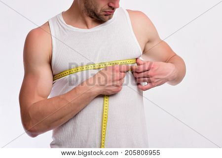 Guy With Flexible Ruler Around Chest Isolated On White Background