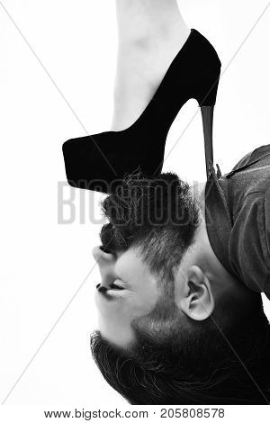 Bearded Man With Sexy Female Leg Has Serious Face