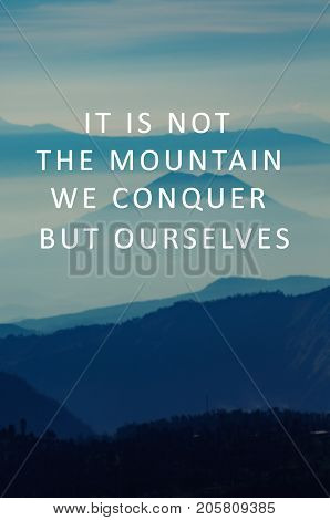 Life Motivational And Inspirational Quotes - It Is Not The Mountain We Conquer But Ourselves. Blurry