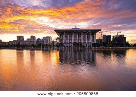 Dramatic sunrise over Sultan Mizan Zainal Abidin mosque also known as masjid besi located in Putrajaya Malaysia.