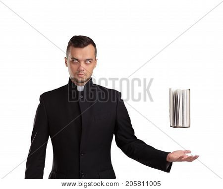 Magical priest with a white eyes. Black book in Catholic priest's hands. Religion concept isolated on a whote background.
