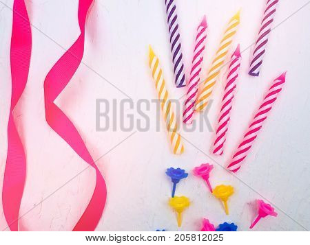Striped Colorful Candles For Birthday Party On White Background. Flat Lay.
