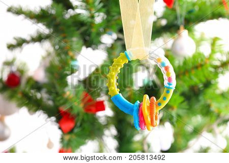 Baby rattle on blurred background