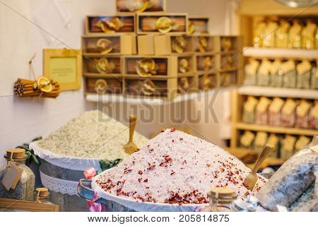 Sale of natural sea medicinal salt for a bath and various medical and therapeutic procedures for health. Shop products for a healthy body. A pile of salt.