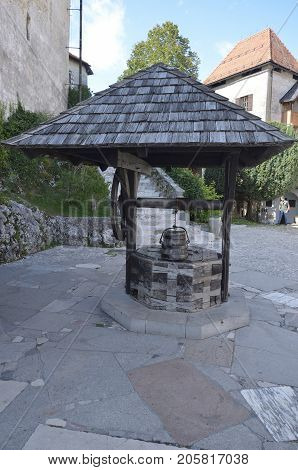 ancient medieval well with a canopy in the courtyard of the castle