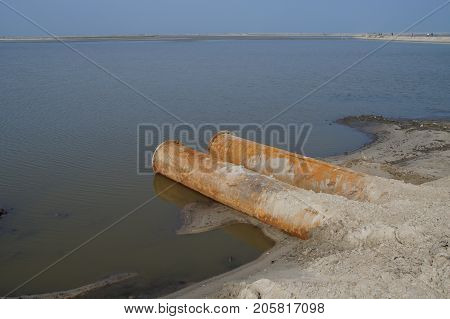 Steel dredging pipes at construction work Marker Wadden in the Dutch Markermeer. Marker Wadden are artificial islands.