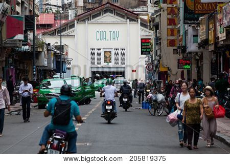 HO CHI MINH CITY (SAIGON), VIETNAM - JULY 2017 : Road traffic in Saigon, Vietnam. In the biggest city in Southern Vietnam there are more than 4 mil. motorbikes, the traffic is often congested