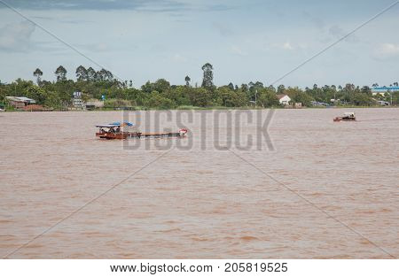 CAN THO, VIETNAM - JULY, 2017: Ferry crossing Mekong River in Vietnam. The Mekong River is a trans-boundary river in Southeast Asia.