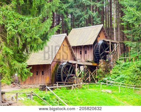 Gold ore mills. Medieval wooden water mills in Zlate Hory, Czech Republic.