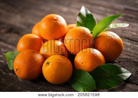 ripe raw orange fruits background many orange fruits - orange fruit background