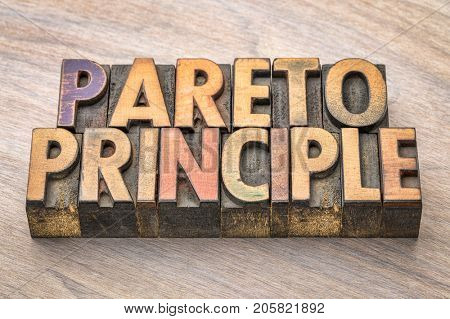 Pareto principle word abstract in vintage wood letterpress printing blocks