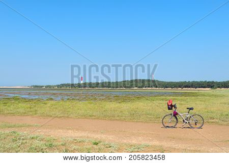 Bike and lighthouse La Coubre at the French Atlantic coast in La Palmyre