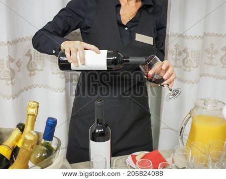 Unrecognisable Woman Serving Wine