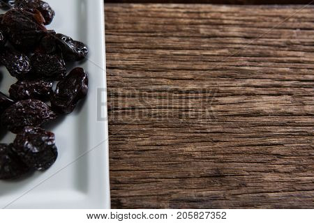 Close-up of date palms in a tray on wooden table