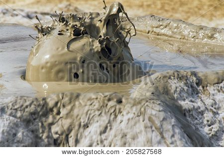 Close-up of erupting mud volcano in Berca Romania