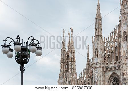 Milan Cathedral or Duomo di Milano with street lamps