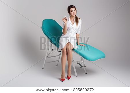 Beautiful Young Girl In White Dressing Gown Master On Permanent Make-up