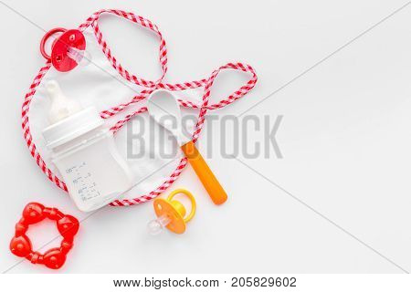 children feeding with breastmilk or infant formula powdered baby milk and toys on white table background top view space for text