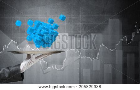 Cropped image of waiter's hand in white glove presenting multiple cubes on metal tray with analytical sketches on dark background. 3D rendering.