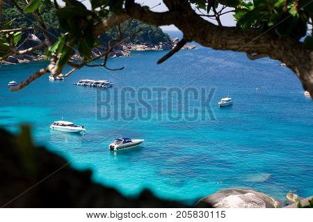 Beautiful sea landscape with tropical coast and the high-speed boat at Tachai island, Phang nga, Thailand