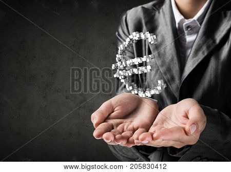 Cropped image of businessman in suit presenting multiple cubes in form of euro sign in his hand. 3D rendering.