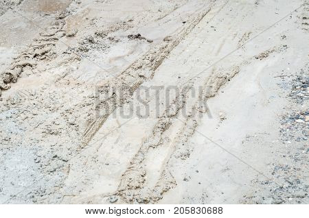 Vehicle tires tracks in the muddy ground